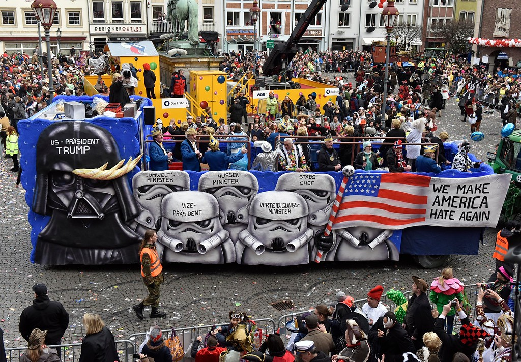 . A carnival float depicts US president Donald Trump as Darth Vader and his cabinet as storm troopers at the traditional carnival parade in Duesseldorf, Germany,  Monday, Feb. 27, 2017. The foolish street spectacles in the carnival centers of Duesseldorf, Mainz and Cologne, watched by hundreds of thousands of people, are the highlights in Germany\'s carnival season on Rose Monday. (AP Photo/Martin Meissner)