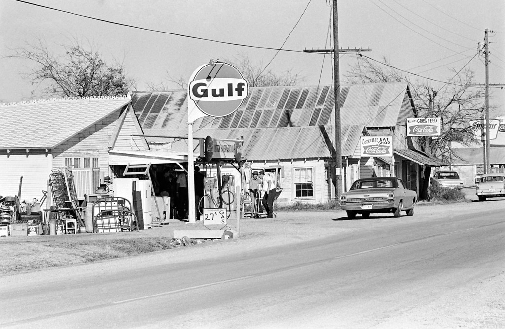 . This is the Watson Grocery & Station where Charles Tex Watson, who is accused in the slaying of Sharon Tate, worked with his father in northeast of Dallas, Dec. 2, 1969, Copeville, Tex. His father, C.D. Watson in hat, talks with a soft drink salesman. (AP Photo/Ferd Kaufman)