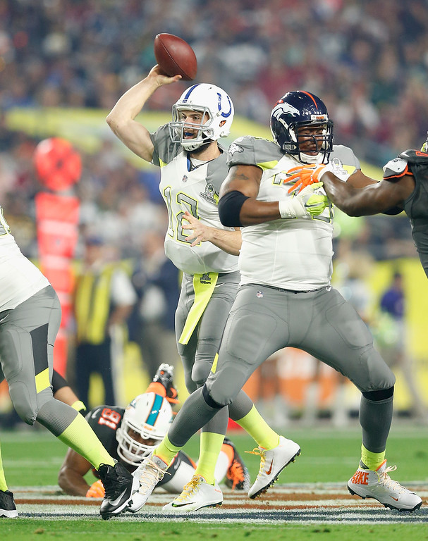. GLENDALE, AZ - JANUARY 25: Team Carter quarterback Andrew Luck #12 of the Indianapolis Colts throws a pass during the first half of the 2015 Pro Bowl at University of Phoenix Stadium on January 25, 2015 in Glendale, Arizona.  (Photo by Christian Petersen/Getty Images)