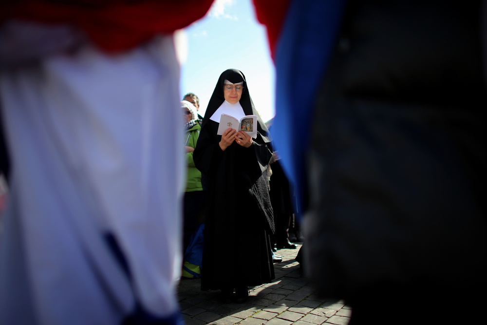 . A nun prays during the Inauguration Mass for Pope Francis in St Peter\'s Square on March 19, 2013 in Vatican City, Vatican. The mass is being held in front of an expected crowd of up to one million pilgrims and faithful who have filled the square and the surrounding streets to see the former Cardinal of Buenos Aires officially take up his role as pontiff. Pope Francis� inauguration takes place in front of Cardinals and spiritual leaders as well as heads of state from around the world.  (Photo by Joe Raedle/Getty Images)