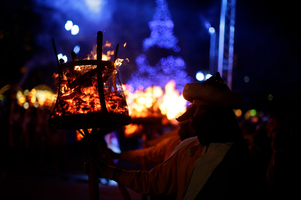 . A performer holds a torch during the \'Cabalgata de Reyes,\' or the Three Wise Men parade in Vic, Spain, Thursday, Jan. 5, 2017. The traditional parade marks the eve of the Epiphany, a Christian holiday celebrating the story of the three wise men believed to have followed a bright star to offer gifts of gold, frankincense and myrrh to the newborn Jesus in Bethlehem. (AP Photo/Manu Fernandez)