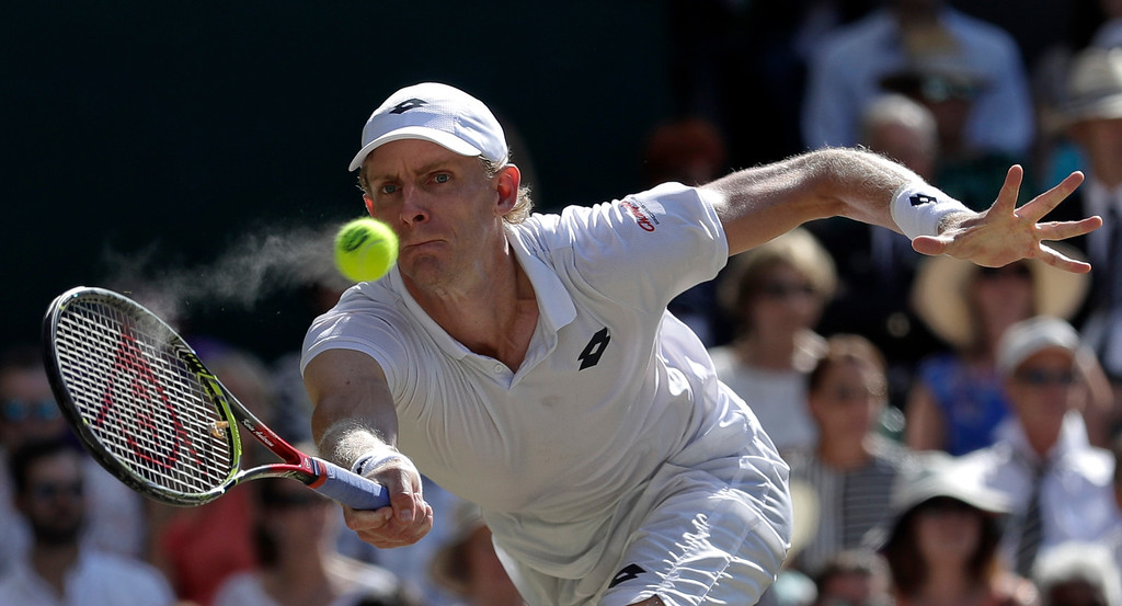 . South Africa\'s Kevin Anderson returns the ball to Serbia\'s Novak Djokovic during the men\'s singles final match at the Wimbledon Tennis Championships in London, Sunday July 15, 2018. (AP Photo/Ben Curtis)