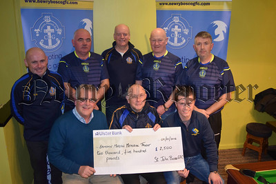 Members of the St John Bosco GAC make a presentation of cheque for £2500 to Eamon Morgan's father and brother, monies raised at the Christmas week Bosco v Quatar football matches and associated events. R1608105
