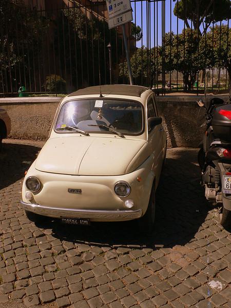 A Fiat 500 parked at the Santa Sabina.