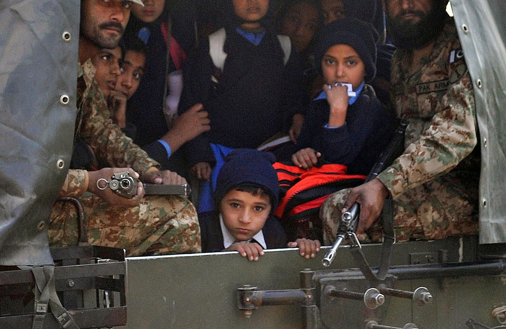 . Pakistani soldiers transport rescued school children from the site of an attack by Taliban gunmen on a school in Peshawar on December 16, 2014. Taliban insurgents killed at least 130 people, most of them children, after storming an army-run school in Pakistan December 16 in one of the country\'s bloodiest attacks in recent years. AFP PHOTO/ A Majeed/AFP/Getty Images