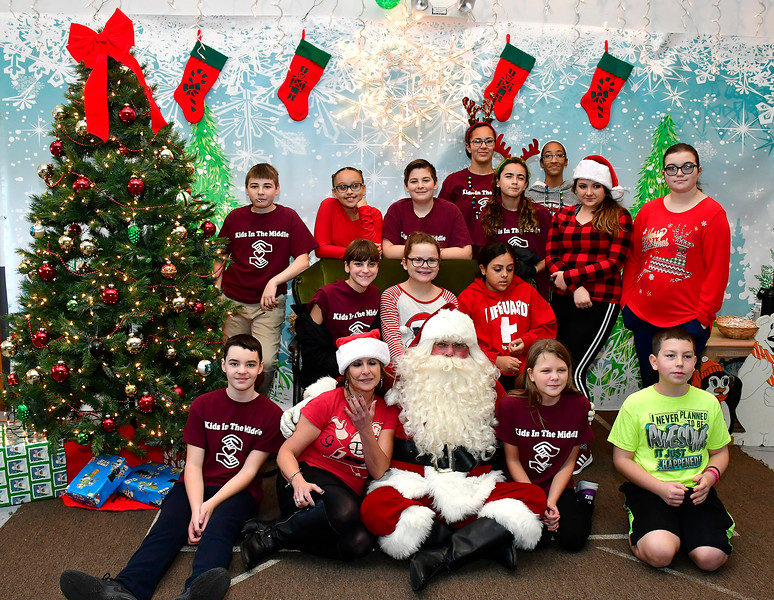 12/01/2018 Mike Orazzi | Staff Santa poses with volunteers from Chippens Hill Middle School Kids in the Middle program during the 25th Annual Breakfast with Santa at the Giamatti Little League Center Saturday in Bristol.