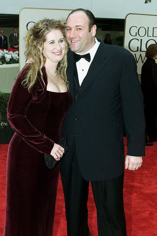 """. Actor James Gandolfini and his wife arrive at the 57th Annual Golden Globe Awards in Beverly Hills, CA, 23 January, 2000. Gandolfini won Best Performance by an Actor in a Television Series - Drama for his role in \""""The Sopranos.\""""  LUCY NICHOLSON/AFP/Getty Images"""
