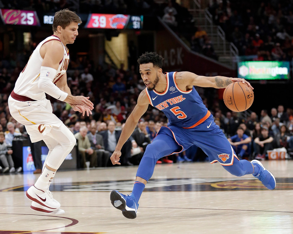 . New York Knicks\' Courtney Lee (5) drives past Cleveland Cavaliers\' Kyle Korver (26) in the second half of an NBA basketball game, Sunday, Oct. 29, 2017, in Cleveland. The Knicks won 114-95. (AP Photo/Tony Dejak)