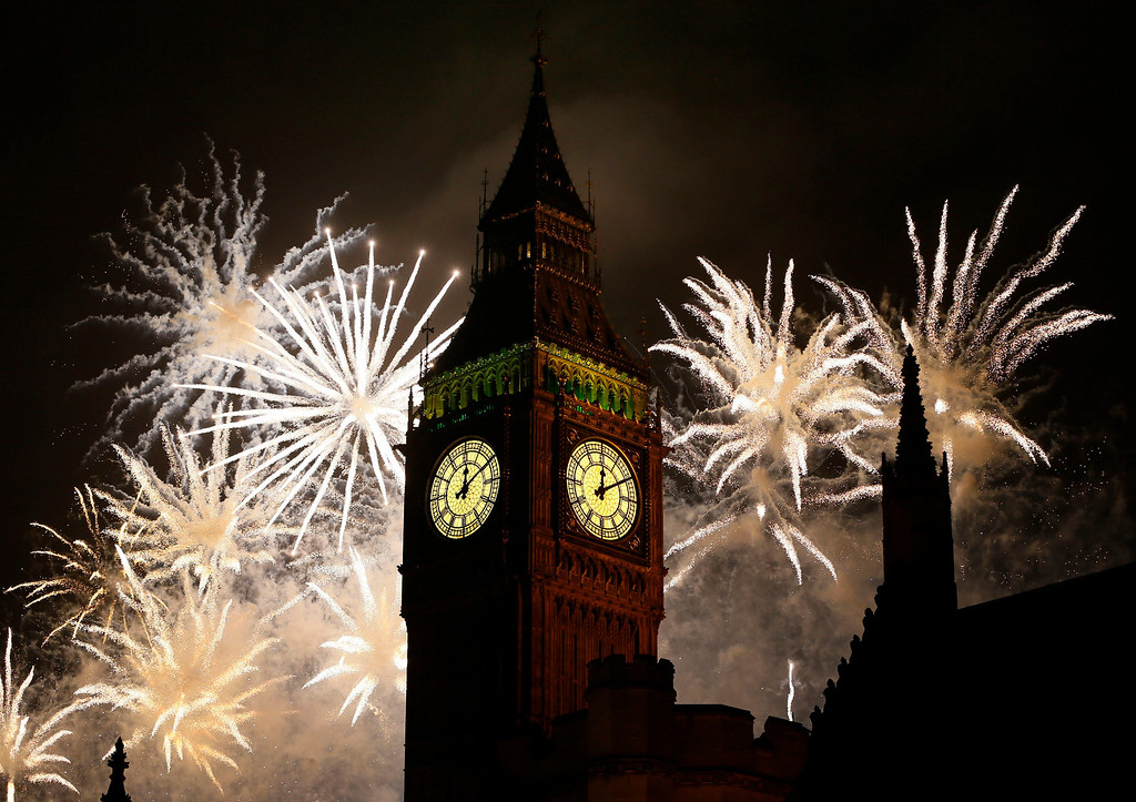 . Fireworks explode over Elizabeth Tower housing the Big Ben clock to celebrate the New Year in London, Tuesday, Jan. 1, 2013. (AP Photo/Kirsty Wigglesworth)