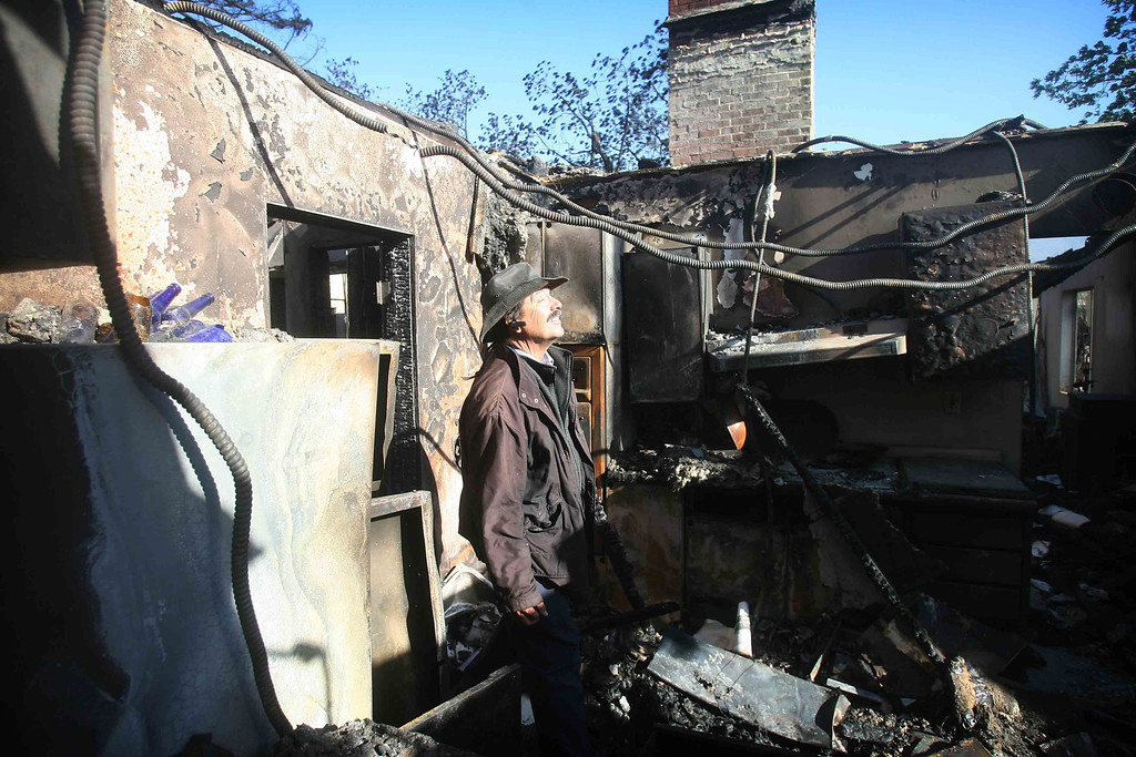 . Joe Kiener stands in what was once the kitchen of his home Thursday morning May 2, 2013, in Riverside County, Calif. His home was completely destroyed as the Summit Fire rolled through his neighborhood late Wednesday.  (AP Photo/The Press-Enterprise,Kurt Miller )