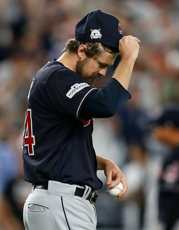 . Cleveland Indians pitcher Andrew Miller (24) reacts after giving up a solo home run to New York Yankees\' Greg Bird during the seventh inning in Game 3 of baseball\'s American League Division Series, Sunday, Oct. 8, 2017, in New York. (AP Photo/Kathy Willens)