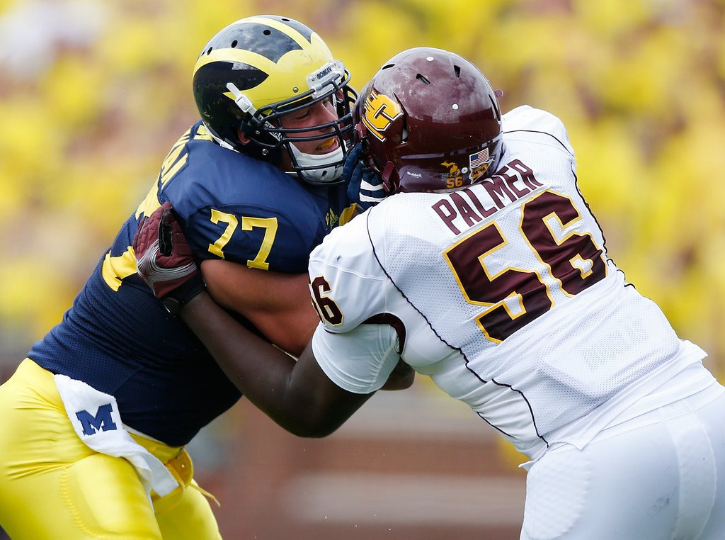 . <p><b>9. Buffalo: Taylor Lewan, OT, Michigan. </b> <p>His dad, Dave Lewan, played at the University of Minnesota. But Taylor Lewan had no mercy on the Gophers as Michigan outscored them 135-26 the past three years.    (Photo by Gregory Shamus/Getty Images)