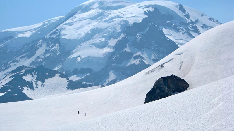 Skiers under Rainier.