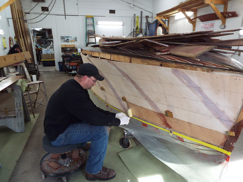 Epoxy being applied to the hull.