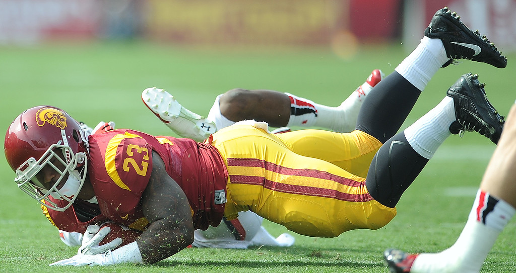 . Southern California running back Tre Madden (23) dives for the first down against Utah during the first half of an NCAA college football game in the Los Angeles Memorial Coliseum in Los Angeles, on Saturday, Oct. 26, 2013.  (Photo by Keith Birmingham/Pasadena Star-News)