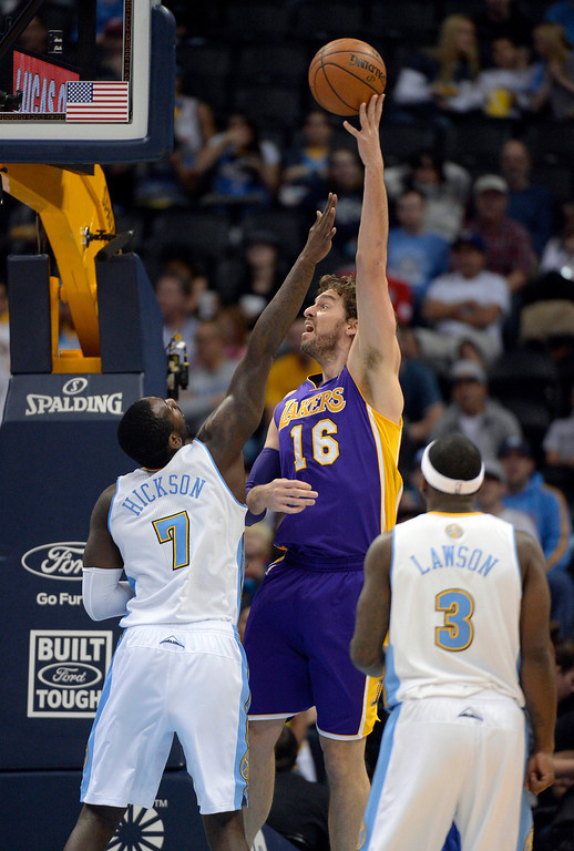 . DENVER, CO - NOVEMBER 13: Los Angeles Lakers center Pau Gasol (16) take a jump hook over Denver Nuggets power forward J.J. Hickson (7) during the first quarter November 13, 2013 at Pepsi Center. (Photo by John Leyba/The Denver Post)