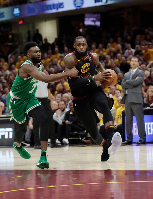 . Cleveland Cavaliers\' LeBron James (23) drives past Boston Celtics\' Jaylen Brown (7) in the first half of Game 3 of the NBA basketball Eastern Conference finals, Saturday, May 19, 2018, in Cleveland. (AP Photo/Tony Dejak)