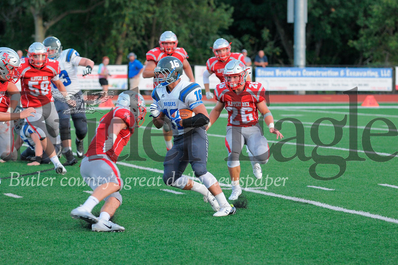 Reynolds #16 Cole Toy tries to get passed Slippery Rock #26 David Duffalo and #5 Kaleb Kamerer during a game at Rocket Stdium on Friday August 31, 2018 (Jason Swanson photo)