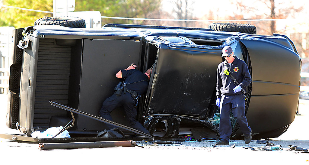 . A police officer checks Carolina Panthers NFL football quarterback Cam Newton\'s truck following a two-vehicle crash not far from the team\'s stadium in Charlotte, N.C., Tuesday, Dec. 9, 2014. Television footage showed Newton on a stretcher being placed in an ambulance. It was unclear how badly the 25-year-old was injured. (AP Photo/The Charlotte Observer, Todd Sumlin)