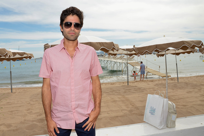 . Adrian Grenier attends Deadline\'s Cocktails on the Croisette in partnership with AmericanExpress and Film Fraternity at La Gold Plage on May 16, 2014 in Cannes, France.  (Photo by Michael Buckner/Getty Images for Deadline Hollywood)