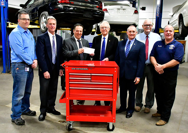 11/1/2018 Mike Orazzi | Staff Ken Crowley while handing over a check to Bristol Tech Thursday morning as part of a program through Crowley Ford. Left to right: Brent Davenport, Tom Moran, Scott Zito, Ken Crowley, Henri Martin, Whit Betts and Rit Dulac.