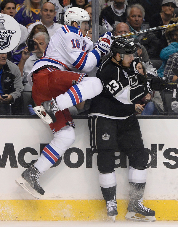 . Rangers Marc Staal and Kings Dustin Brown collide in the first period.  The Los Angeles Kings faced the New York Rangers in game 1 of the Stanley Cup Finals. Los Angeles, CA. 6/4/2014(Photo by John McCoy / Los Angeles Daily News)