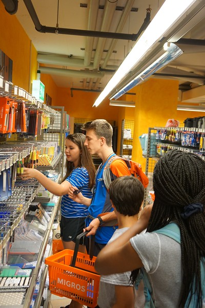 Hannah, Dylan, Hunter, and Alyssa picking out their pens for class