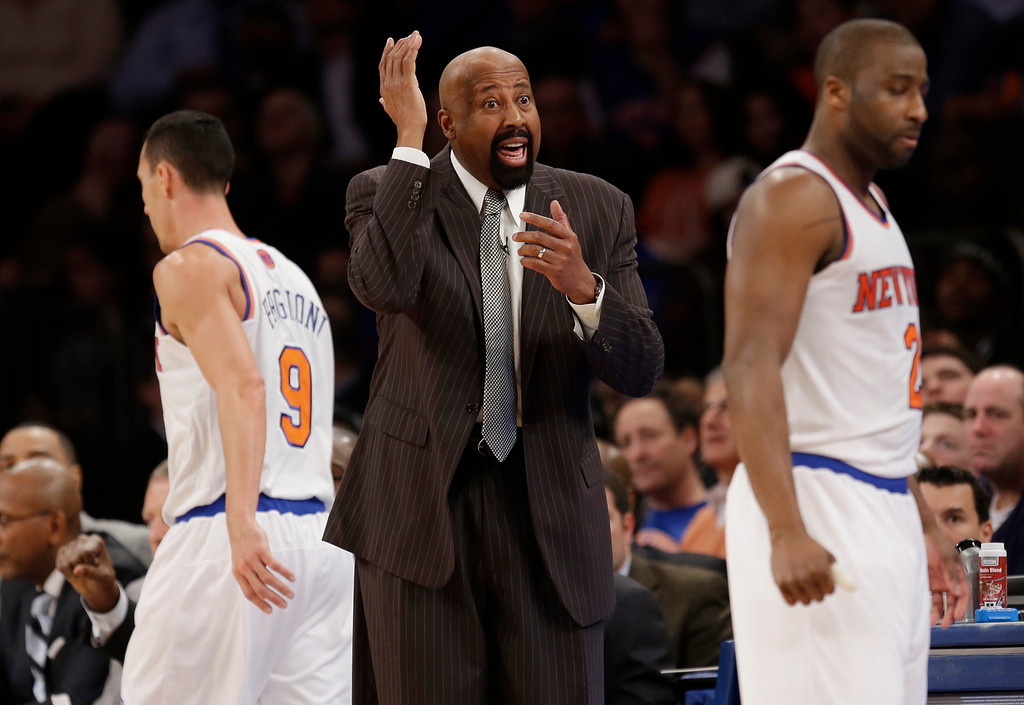 . New York Knicks\' Mike Woodson talks to the referee during the second half of the NBA basketball game against the Los Angeles Lakers at Madison Square Garden Sunday, Jan. 26, 2014, in New York. The Knicks defeated the Lakers 110-103. (AP Photo/Seth Wenig)