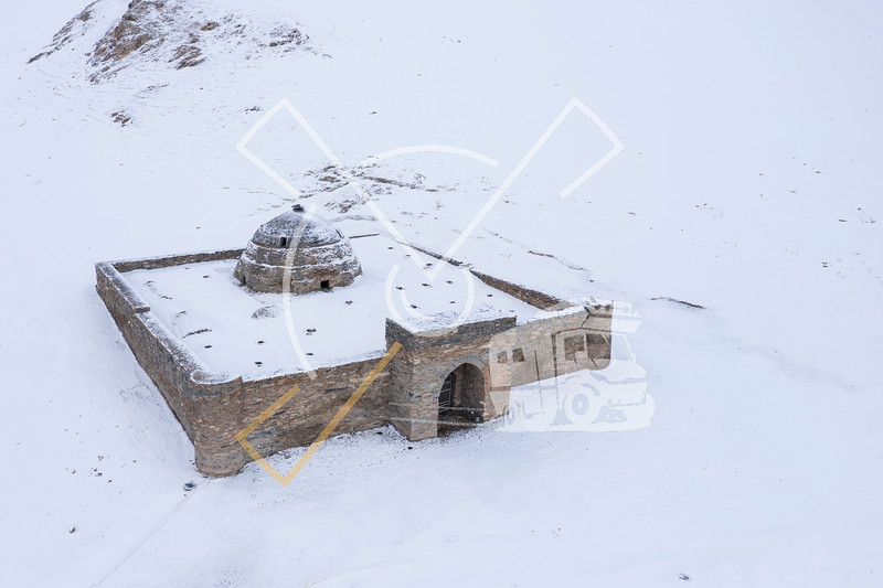 Aerial view on the Tash-Rabat caravanserai covered in the first snow of winter