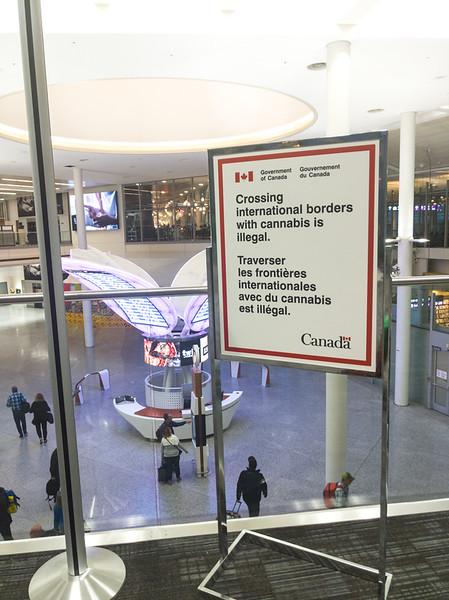 airport weed marijuana sign.jpg