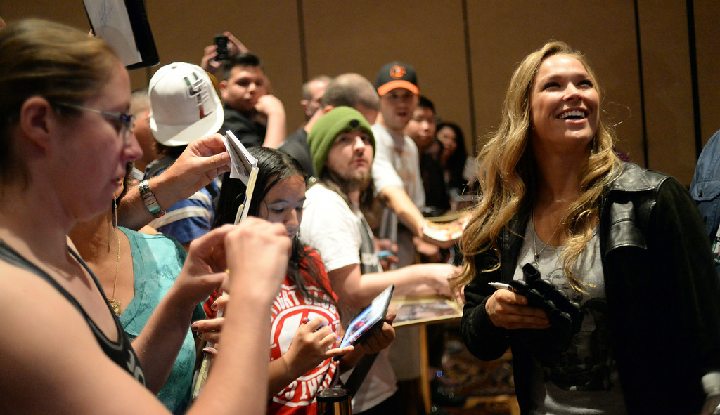 . UFC Women\'s Bantamweight Champion Ronda Rousey takes some time with fans during Ultimate Media Day at the Mandalay Bay Events Center Thursday, July 3, 2014. (Photo by Hans Gutknecht/Los Angeles Daily News)