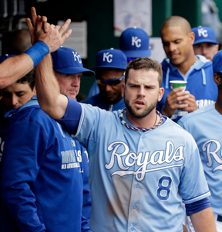 . Kansas City Royals\' Mike Moustakas celebrates in the dugout after hitting a three-run double during the second inning of a baseball game against the Colorado Rockies Wednesday, May 14, 2014 in Kansas City, Mo. (AP Photo/Charlie Riedel)