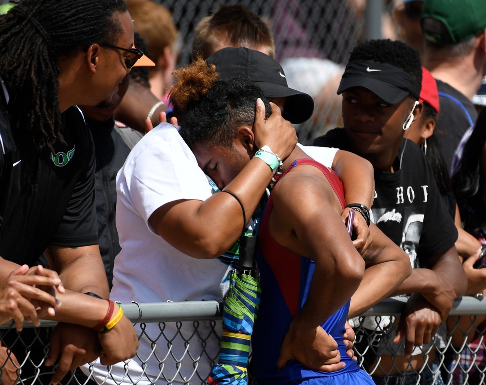 . Christian Lyon, Fountain-Ft. Carson, gets a hug from his mother Joy Smith-Lyon after Christian won the boys 5A 100 meter dash final at the Colorado Track and Field State Championships at Jeffco Stadium May 21, 2016. Lyon won with a time of 10.80  (Photo by Andy Cross/The Denver Post)