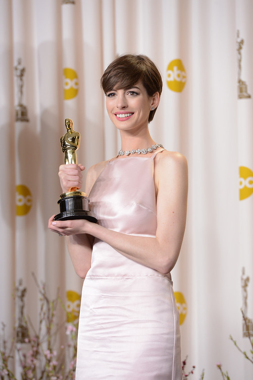 ". Anne Hathaway accepts the award for best actress in a supporting role for ""Les Miserables\"" backstage at the 85th Academy Awards at the Dolby Theatre in Los Angeles, California on Sunday Feb. 24, 2013 ( David Crane, staff photographer)"