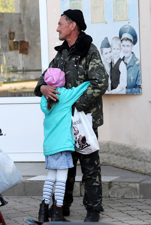 . A Ukrainian soldier embraces his daughter at the Belbek air force base not far from the city of Sevastopol, in Crimea, on March 21, 2014. AFP PHOTO / VIKTOR  DRACHEV/AFP/Getty Images