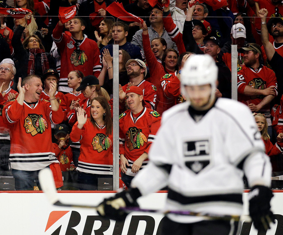 . Chicago Blackhawks fans celebrates after Duncan Keith scored as Los Angeles Kings\' Slava Voynov (26) looks down during the second period in Game 1 of the Western Conference finals in the NHL hockey Stanley Cup playoffs in Chicago on Sunday, May 18, 2014. (AP Photo/Nam Y. Huh)