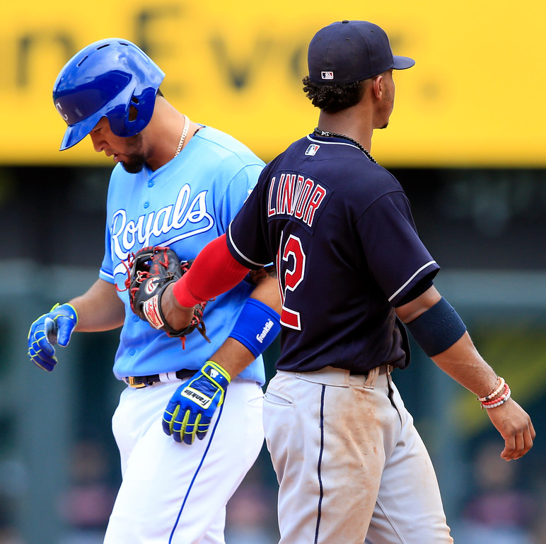 . Kansas City Royals\' Cheslor Cuthbert, left, is tagged out by Cleveland Indians shortstop Francisco Lindor (12) after his two-run single during the fifth inning of a baseball game at Kauffman Stadium in Kansas City, Mo., Sunday, Aug. 20, 2017. (AP Photo/Orlin Wagner)