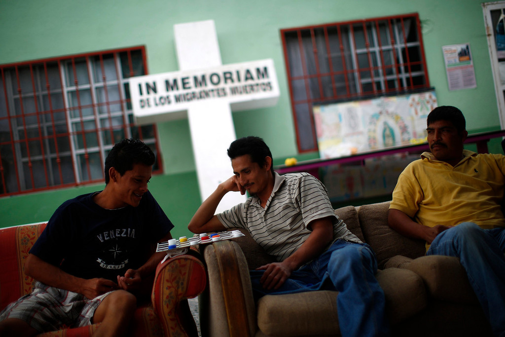 ". People sit on a couch at Casa del Migrante in Reynosa April 1, 2013. Casa del Migrante provides housing, food, clothing and medical care to people who are planning to cross the border, and to those who have been deported from the United States. Brooks County has become an epicentre for illegal immigrant deaths in Texas. In 2012, sheriff\'s deputies found 129 bodies there, six times the number recorded in 2010. Most of those who died succumbed to the punishing heat and rough terrain that comprise the ranch lands of south Texas. Many migrants spend a few days in a ""stash house\"", such as the Casa del Migrante, in Reynosa, Mexico, and many are ignorant of the treacherous journey ahead. Picture taken April 1, 2013. REUTERS/Eric Thayer"