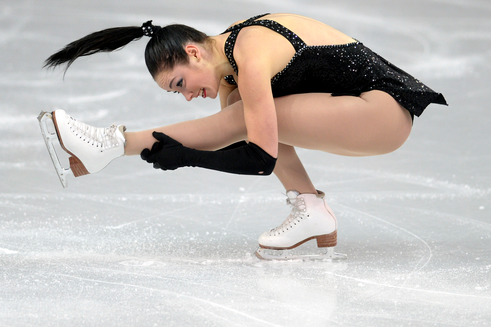 . Canada\'s Kaetlyn Osmond tucks en route to a 62.54 in ladies short program during team figure skating. Sochi 2014 Winter Olympics on Saturday, February 8, 2014. (Photo by AAron Ontiveroz/The Denver Post)