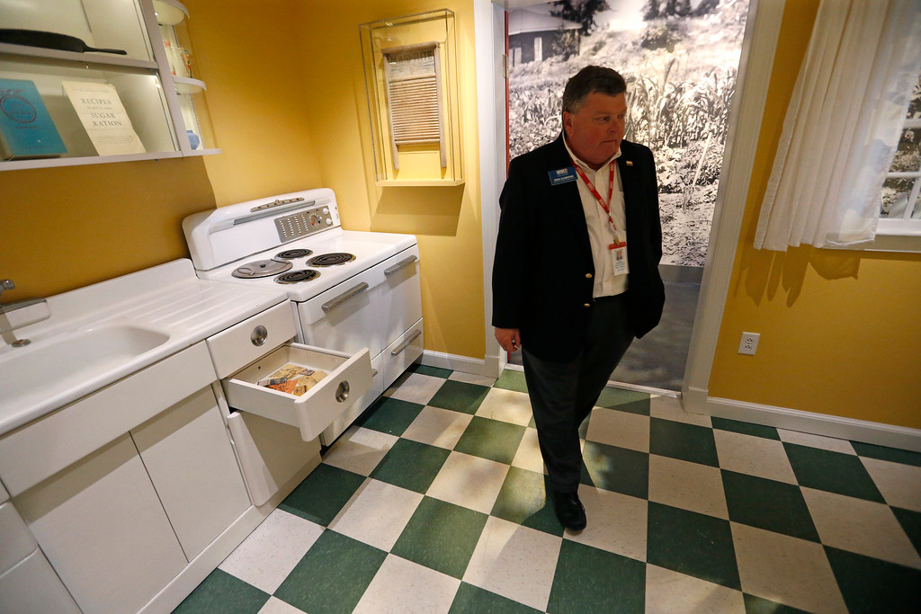 ". Owen Glendening, National World War II Museum vice president for education and access, walks through a mockup of a 1940s era kitchen, part of the permanent exhibit ""Salute to the Home Front\"" at the museum which will open to the public this Saturday, in New Orleans, Monday, June 5, 2017. The exhibit tells the home front story from the 1920s to the development of the atomic bomb. (AP Photo/Gerald Herbert)"