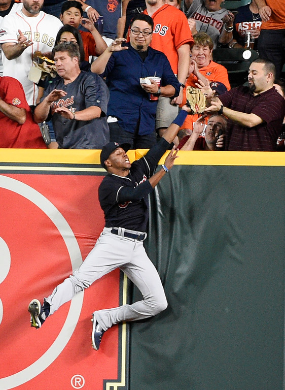 . Cleveland Indians right fielder Greg Allen catches a fly ball hit by Houston Astros\' Alex Bregman during the first inning of a baseball game Friday, May 18, 2018, in Houston. (AP Photo/Eric Christian Smith)