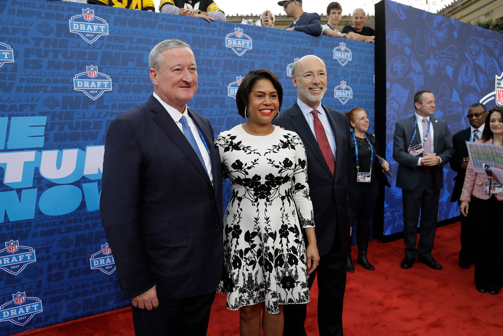 . Philadelphia mayor Jim Kenney, left, and Pennsylvania Gov. Tom Wolf, right, pose on the red carpet before the first round of the 2017 NFL football draft, Thursday, April 27, 2017, in Philadelphia. (AP Photo/Julio Cortez)