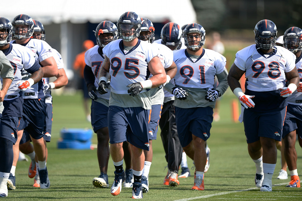 . The defense heads to drills on the first day of the Denver Broncos 2014 training camp July 24, 2014 at Dove Valley. (Photo by John Leyba/The Denver Post)