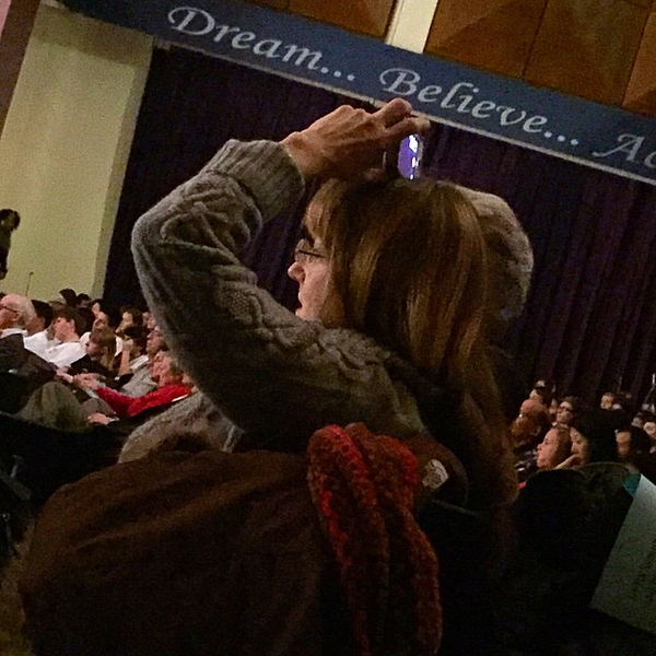 Certainly one way to balance your phone ... sorry, video camera ... while your kid performs in the 6th grade orchestra concert.