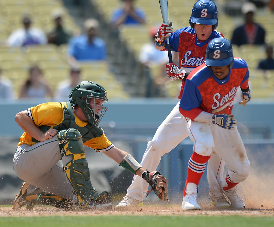 . Serra\'s Denz\'l Chapman (23) steals home in the fourth before Mira Costa catcher Austin Henning can make the play in the CIF-SS Division III championship baseball game Friday at Dodger Stadium. Serra won the title, 8-1. 20130531 Photo by Steve McCrank / Staff Photographer