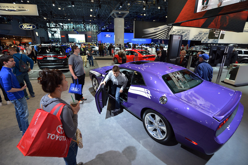 . People view a 2013 Dodge Challenger RT at a public preview of the New York International Auto Show on March 29, 2013 in New York.   STAN HONDA/AFP/Getty Images