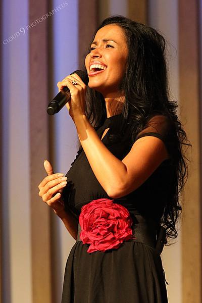 AMER-CMM 00005 Heritage Singers Adrianne Mace sings before a church audience by Peter J Mancus.JPG