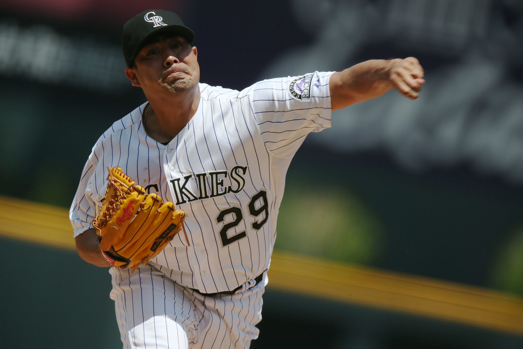 . Colorado Rockies starting pitcher Jorge De La Rosa works against the Washington Nationals in the first inning of a baseball game in Denver on Wednesday, July 23, 2014. (AP Photo)