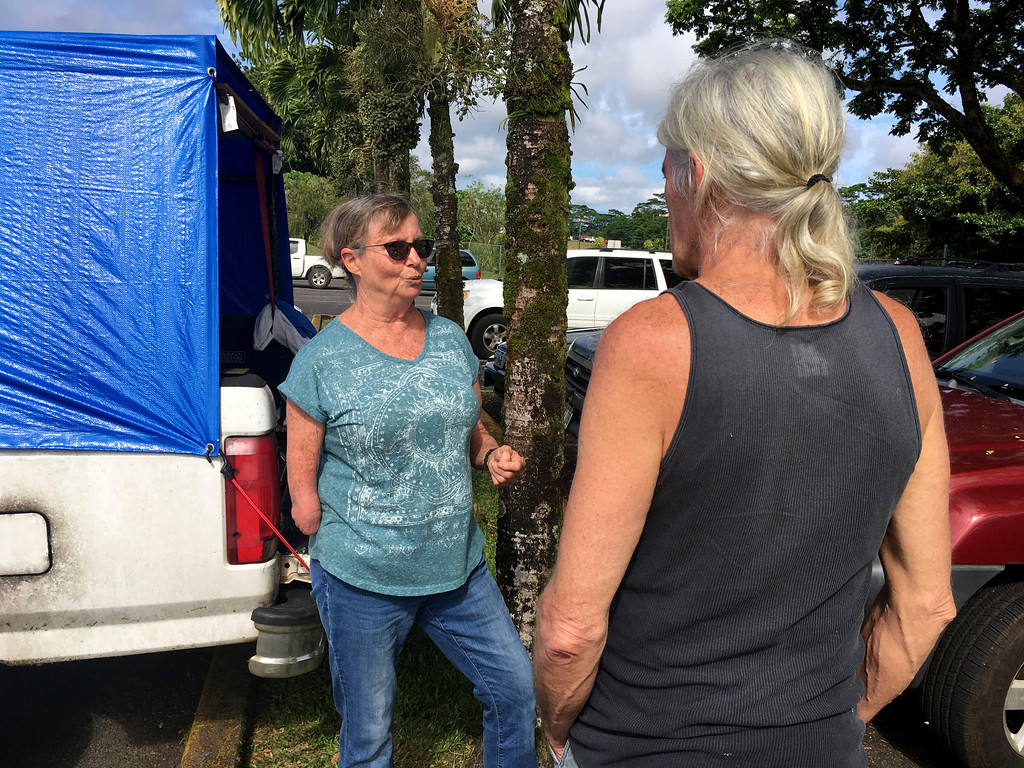 . Cherie McArthur and Michael McGuire, who live in the mandatory evacuation zone near Kilauea volcano, talk at a shelter in Pahoa, Hawaii on Sunday, May 6, 2018. Officials on Hawaii\'s Big Island say what started out as a small spattering of lava from the ground Saturday night only took minutes to become cascading fountains. U.S. Geological Survey volcanologist Wendy Stovall says lava fountains spewed as high as 230 feet (70 meters) into the air only 15 minutes after the initial eruption from a the latest of several new fissures in the area. (AP Photo/Haven Daley)