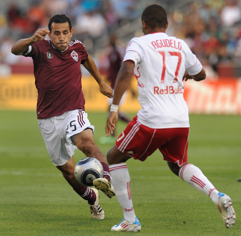 . Colorado midfielder Pablo Mastroeni (25) tried to work the ball past New York forward Juan Agudelo (17) in the first half.  The Colorado Rapids hosted the New York Red Bulls at Dick\'s Sporting Goods Park in Commerce City Wednesday night, July 20, 2011.   Karl Gehring/ The Denver Post